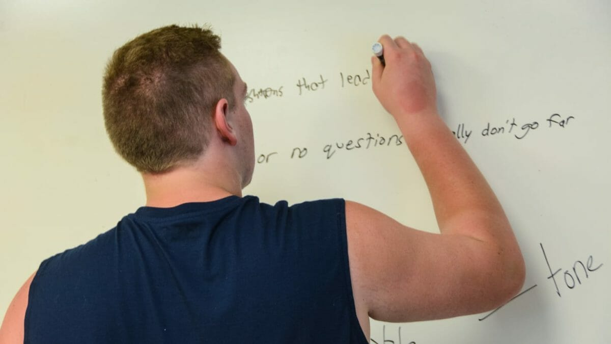 Writing on whiteboard in College Prep course
